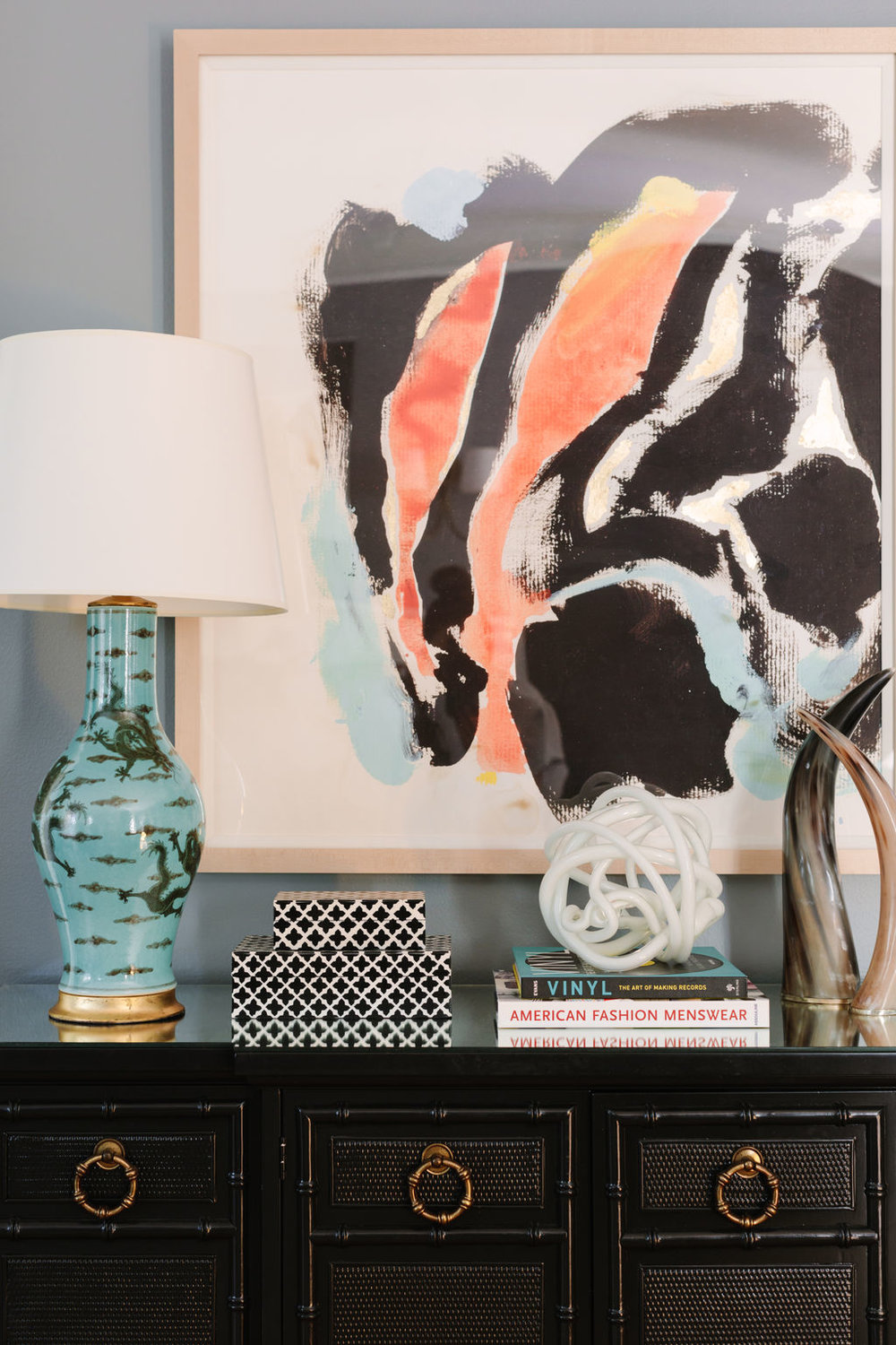 Chicago interior designer Bungalow 5 porcelain lamp, black bamboo chest with brass hardware, Two's Company black and white boxes, Arteriors horns