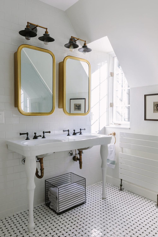 Chicago interior designer white bathroom, Pottery Barn pedestal sink, Restoration Hardware antique brass vanity mirror/medicine cabinets and barn light sconces