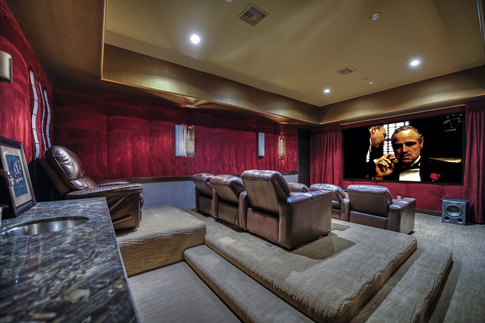 Movies, anyone? Our Men's Residence has its very own movie room with plush theater-style seats and a wide-selection of movies.