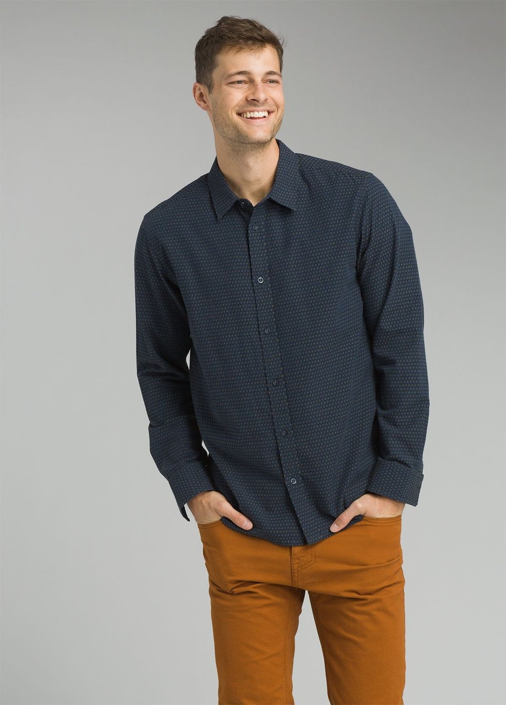Prana  men's breathable fair trade button down shirts. Convenient front pocket for lens caps. Prana has a huge selection (and they're good for the environment).