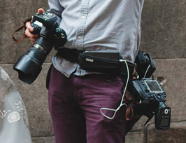 SpiderPro  harnesses are waist belts that can hold up to two cameras and accessories. Cameras snap in and out of them, which is so helpful and quick! Prices and features range: $150-265.