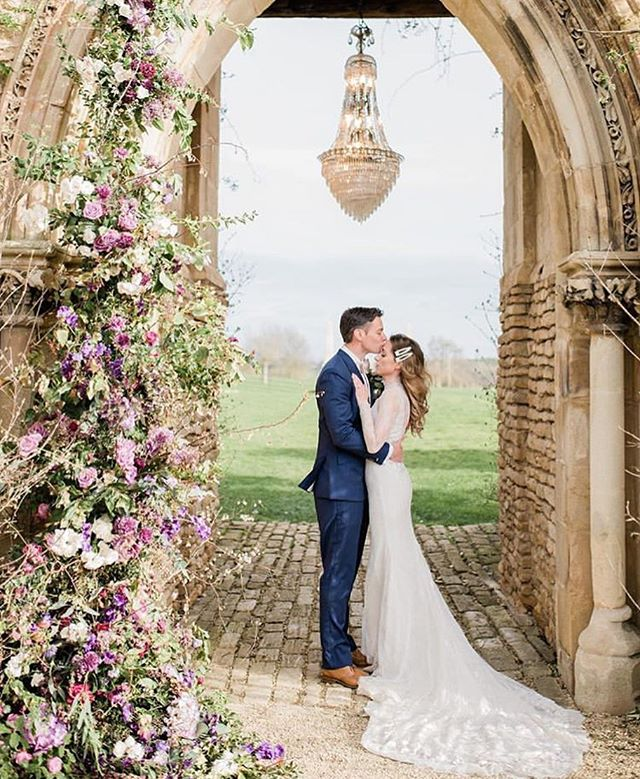 Reposting this stunning image of a recent shoot curated by @forthelove_of_weddings and captured by @katrinabartlam  Although it is a styled shoot, it is a real couple and the dress is the actual bespoke dress I created for her wedding. So magical to see it getting a second wear. Full shoot credits:  Photographer @katrinabartlam Videographer @rollingfilmltd⁣ Planned + styled by @forthelove_of_weddings⁣⠀ Floral Design + concept @honeysuckleflowerco⁣⠀ Venue, Valentina's Lost Orangery @euridge_events⁣⠀ Cake designer @uniquecakesbyyevnig⁣⠀ Bridal gown @siennavhildemar⁣⠀ Bride's shoes @maisonvalentino⁣⠀ Bride's jacket @marianahardwick⁣⠀ Jewellery @tillythomaslux⁣⠀ Crown @miss_clemmie_bridalaccessories⁣⠀ Hair @joanna_ricarda_hair⁣⠀ Make-up @sashabrownmakeupartist⁣⠀ Groom's attire @asuitthatfits⁣⠀ Stationery @ohwondercalligraphy ⁣⠀ Tablewares @vintagegoldchina⁣⠀ Silk habatai ribbon + runner | velvet ribbons @pompomblossom ⁣⠀ Favours + scent @jomalonelondon Models (real Mr+Mrs) @claireybe@p_whitters