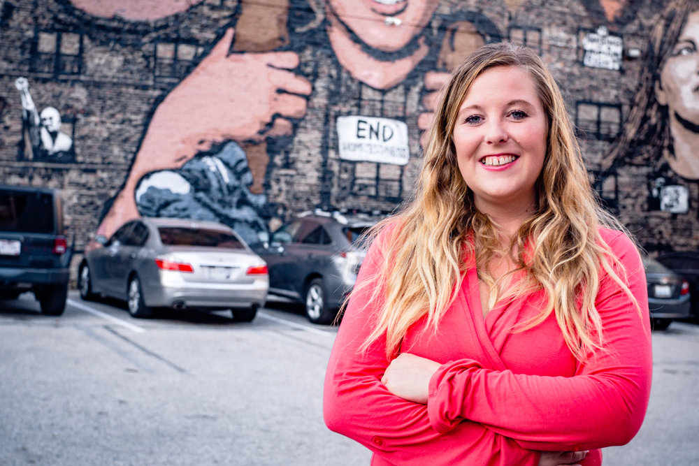 Anna Hayes in front of Faces of Homelessness Mural /  photo by Salvador Mendoza
