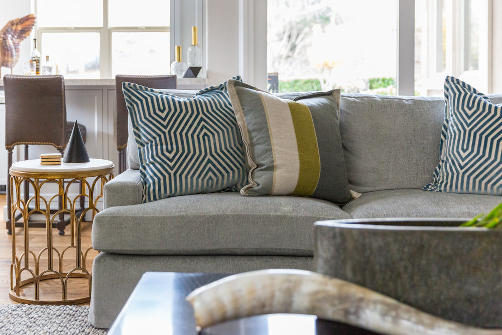 Patterned accent pillows and contrasting colors make for a playful space.