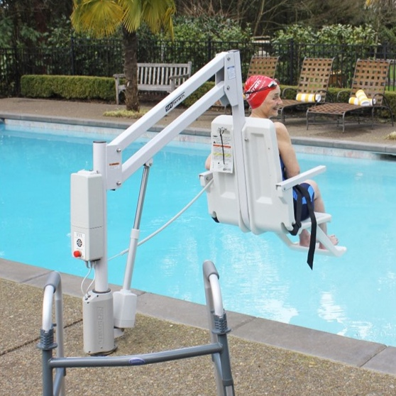 A woman lowering herself into her backyard pool with a lift from S.R. Smith.