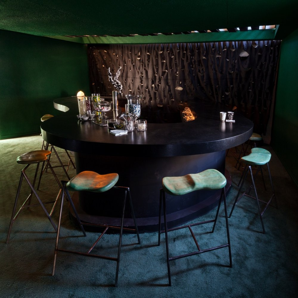 Isaac and Michael designed and built the piano shaped bar while Nik Gelormino designed and built the bespoke barstools.