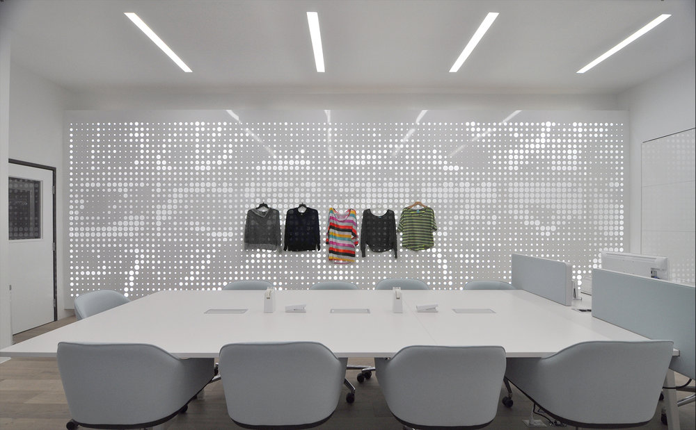 Clothes can be hung at multiple heights easing the way looks can come together on the wall.