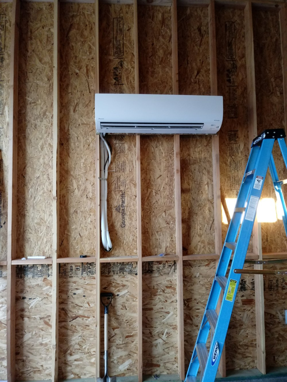 mini split installed on framed wall.JPG