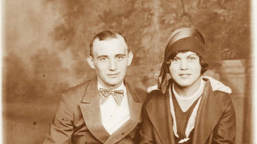 Sepia tone archival photo of young couple, Uncle Otto and Aunt Sophie, circa 1929.