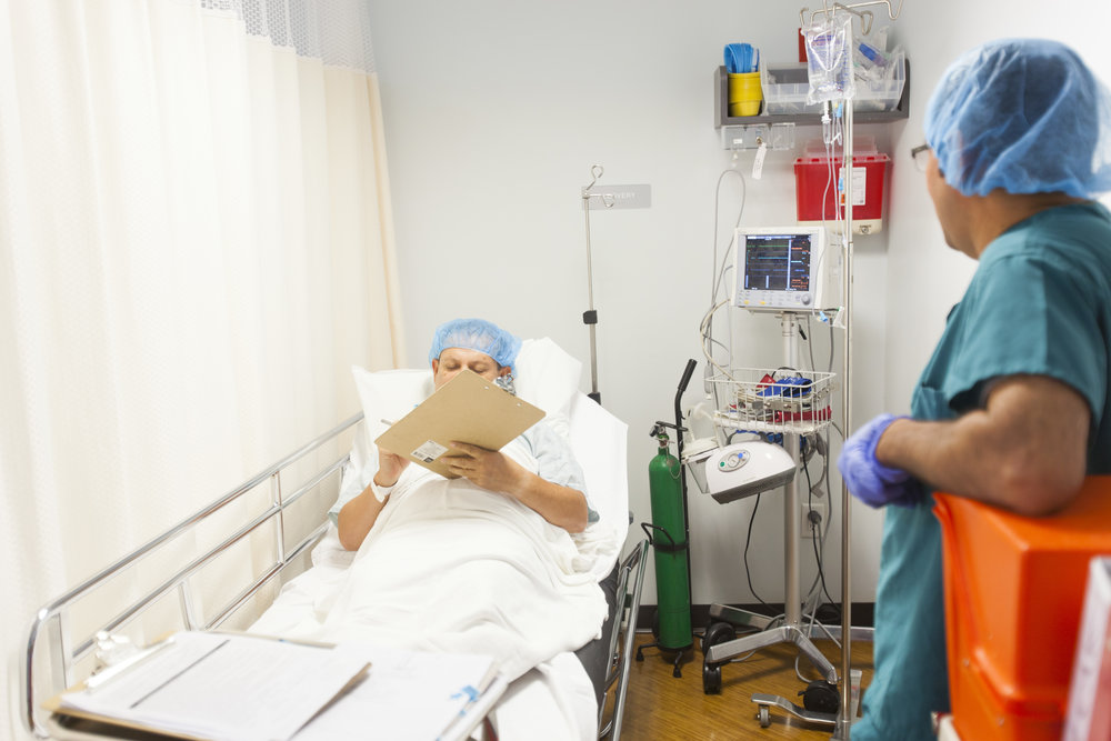 PATIENTS signing paper before the colonoscopy procedure