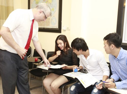 Patrick O'Grady working with Students at English Hanoi