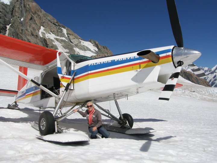 The Director of Scenic Flight Booker's Wife with a Mount Cook Skiplane on NZ's Tasman Glacier
