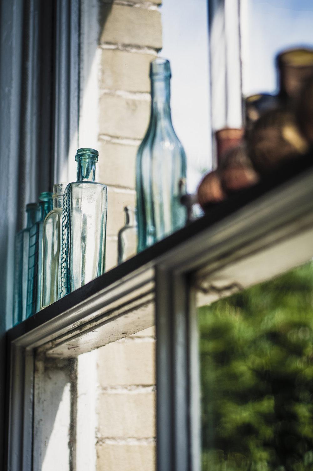 Bottles on shelf.jpg