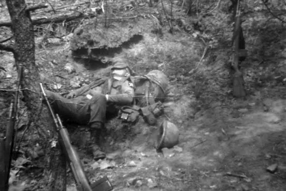 The author takes a snooze in the DMZ in the middle of a three-day patrol (Spring1968).