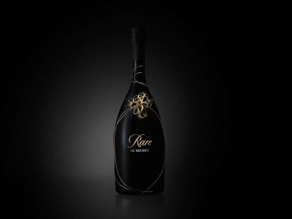 Le Secret - A secret cuvée from Régis Camus, decorated by Mellerio, the oldest jeweler in the world. For discerning champagne enthusiasts, Rare Champagne presents the exclusive limited-edition cuvee Rare Le Secret. Rare Le Secret Fine Jewelery Edition and Rare Le Secret Goldsmith Edition are presented in two different magnums designed by Mellerio, the oldest jeweler in the world.