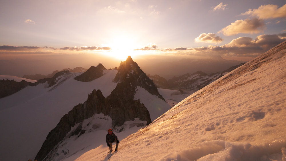 Sunrise in the high mountains, the essence of Alpinism