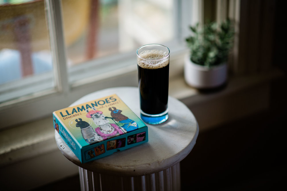 coffee in tall glass with llama dominoes on podium