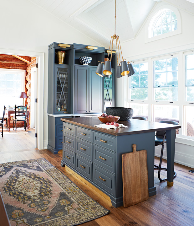 Bright cottage kitchen with dark blue cabinets