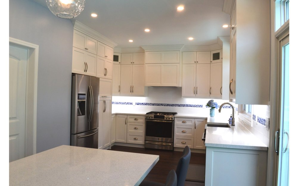 Kitchen with white cabinets and white countertop