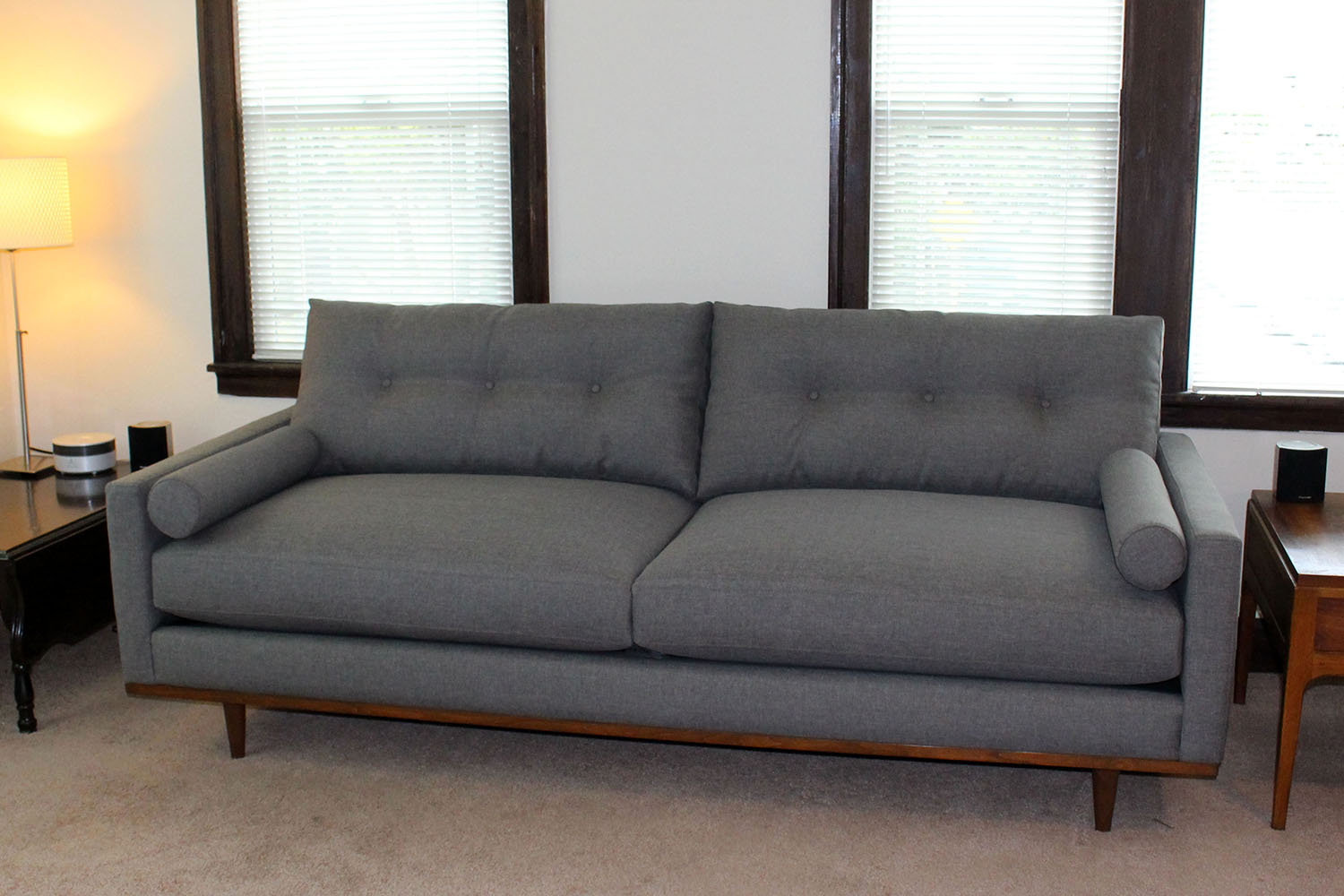 Jessie style sofa with buttons wood base furniture envy