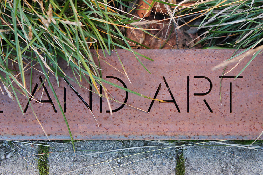 Metal banding is inscribed with historic and current quotes from neighborhood members as well as the global community.