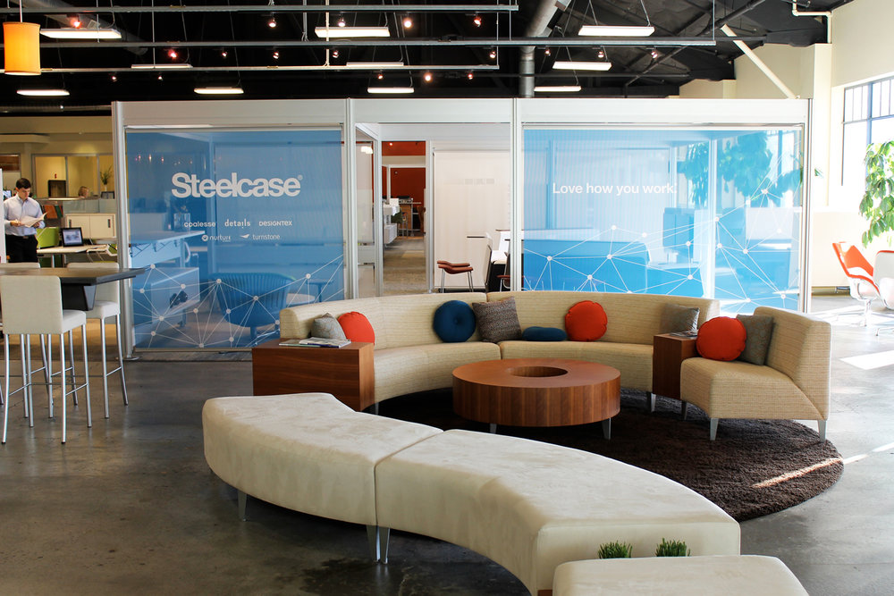 SmithCFI, a Steelcase Premiere Partner, has since been rebranded to Hyphn and entry stair text has been updated accordingly.