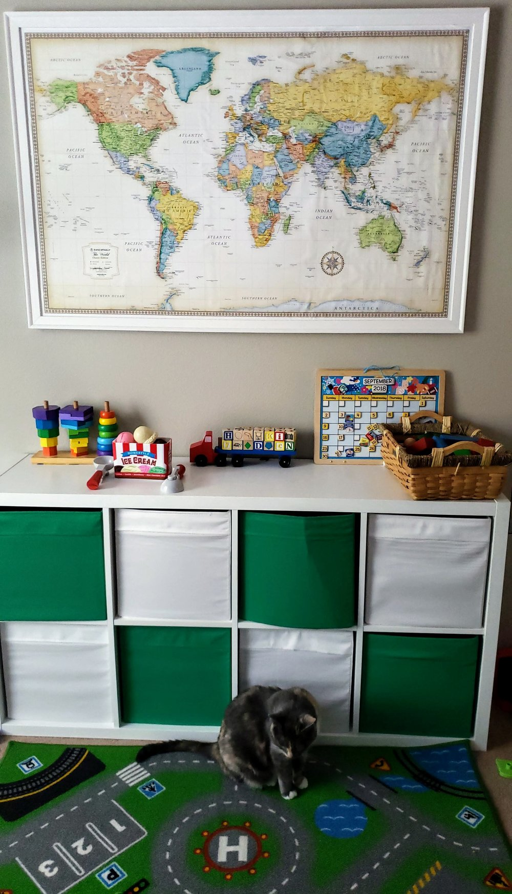 Does anyone else think we should buy stock in Melissa and Doug? Anyway, I love this side of the playroom and LOVE the Rand McNally map on the wall (my son is such a geography buff that we are always standing by it, pointing out the different continents and countries)!  The storage cubby came from IKEA, which I am having a hard time finding online, but I linked one very similar.   World map    Storage cubby (Similar)    Rug