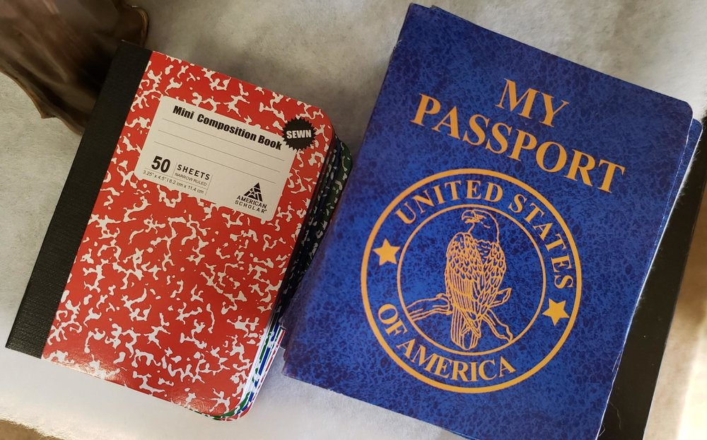 Each guest received a passport when they arrived (which I will explain in more detail in just a sec). I ordered the cute blue passports from Oriental Trading and the little composition notebooks were — you guessed it — Dollar Tree.