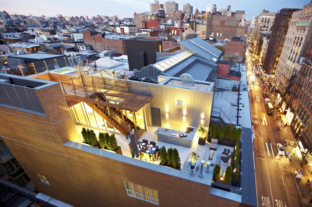 Loci 20: Week 10 - November 28, 2018Week 10: In Soho's historic district along lower Broadway, we renovated an existing dupl aex in 2011, adding a new penthouse to create a stunning four-bedroom triplex and roof terrace. Bluestone and a pergola built with sustainably-harvested ipé wrap the top floor. The lower terrace has an outdoor kitchen, fire pit, and dining area and the upper terrace has a hot tub and sun deck with sweeping views of the downtown skyline.