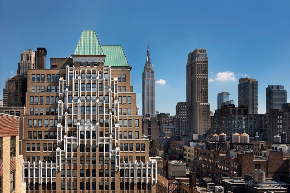 Loci 20: Week 12 - December 12, 2018Week 12 - another highlight from the past 20 years: Several years ago we restored the largest property in the GFP Real Estate portfolio (formerly Newmark Grubb Knight Frank) that consists of three connected buildings in the Garment District that reflect a range of early-20th century architectural styles. Our project team meticulously analyzed the original construction types and developed appropriate details for each building that stabilized or replaced severely deteriorated building components, such as the decorative terra cotta, copper gutters, parapets, skylights, and balconies.