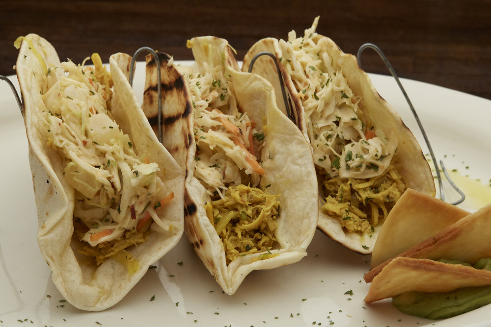Chicken Tacos - Perfectly marinated zesty chicken smothered with citrusy slaw.