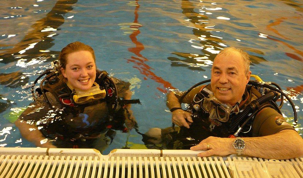 LUEC instructor Cliff teaches trainee Alisha scuba basics during her try dive