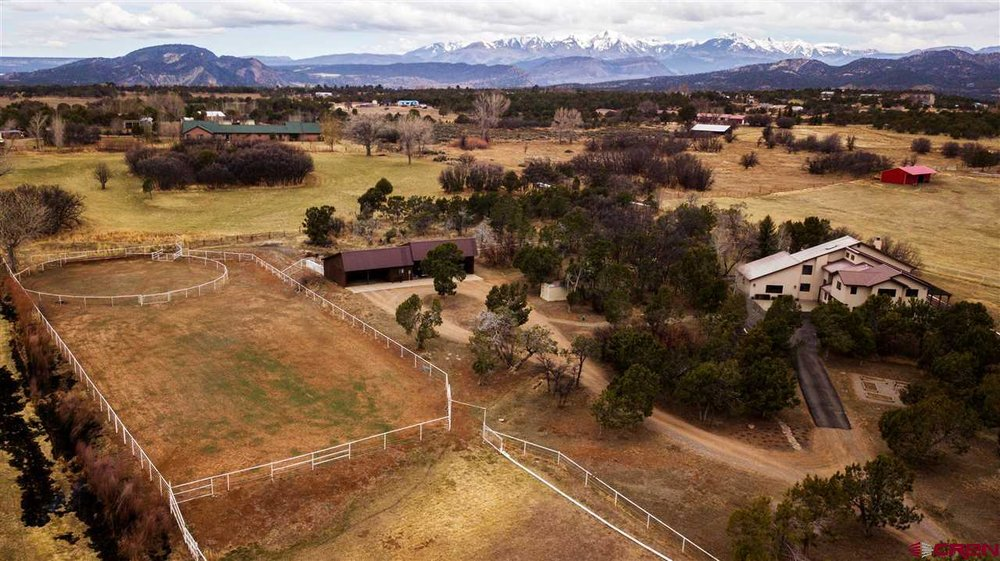 422 Meadowlark Lane is a 3700 square foot home with barn, arena, pasture and irrigation-all just 10 minutes to downtown Durango.  CLICK FOR DETAILS