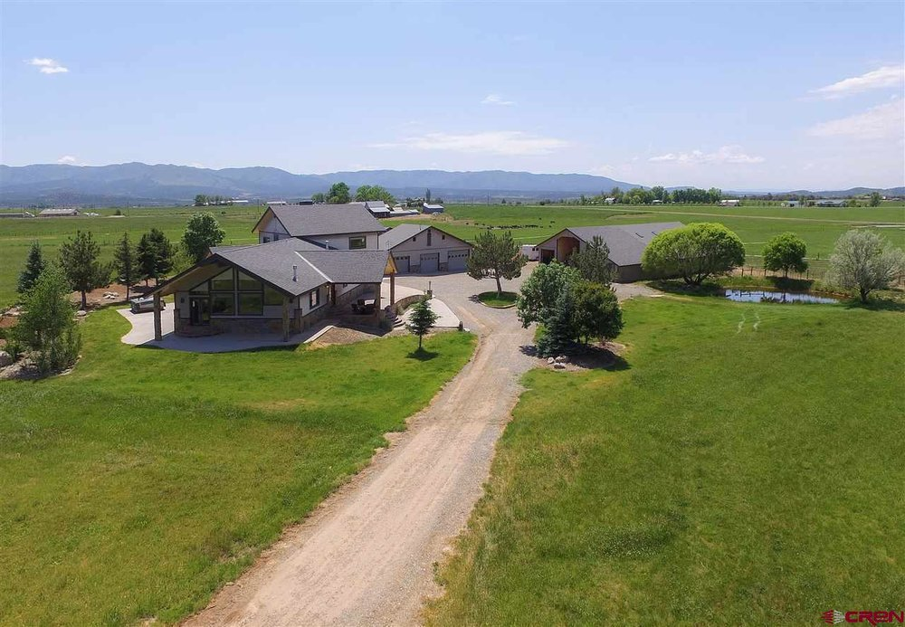 25 irrigated acres with 7 stall barn, 3900 square foot house, guest house, RV parking with hookup in Bayfield.   CLICK FOR DETAIL   S