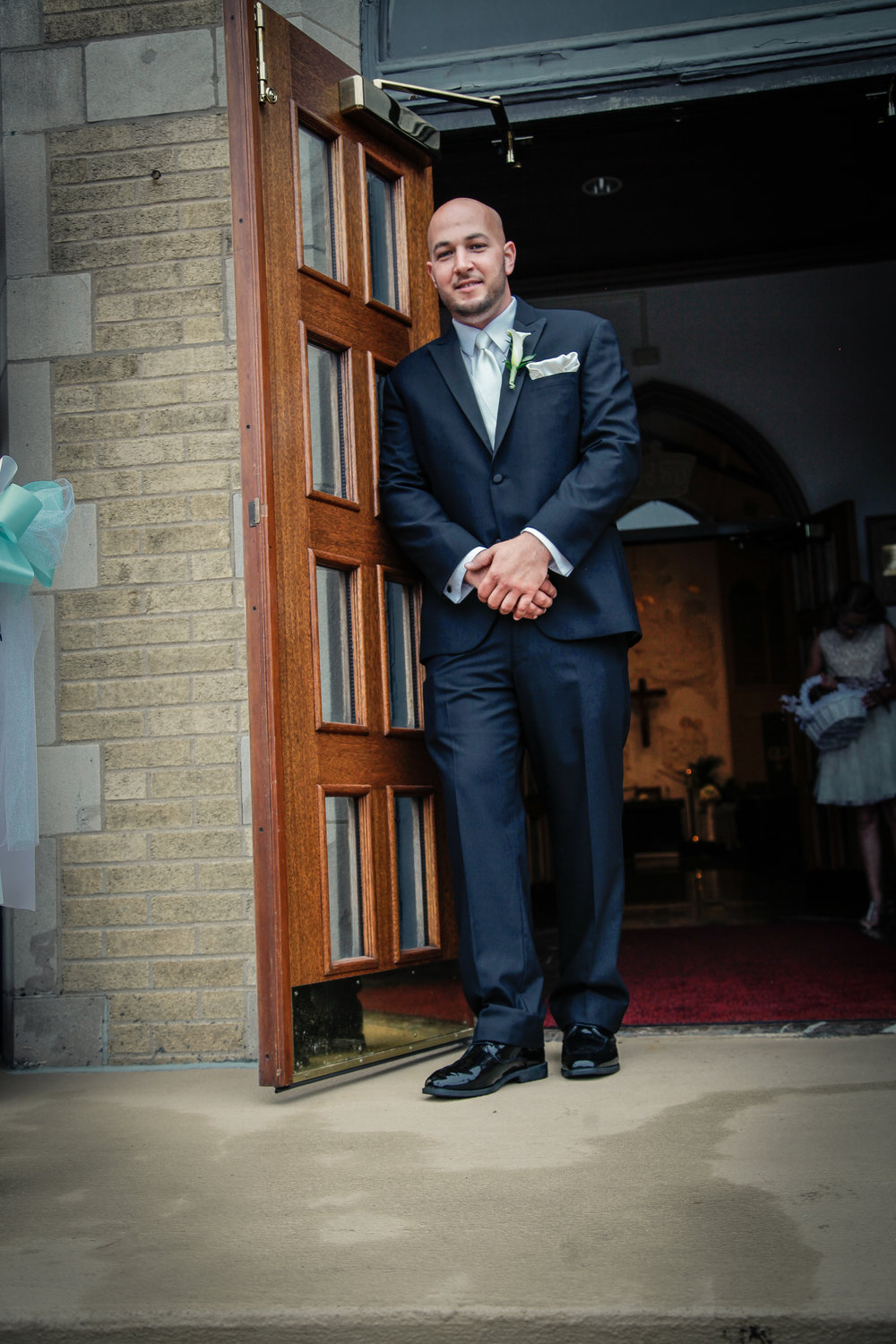Groom wearing Slim fit black tuxedo