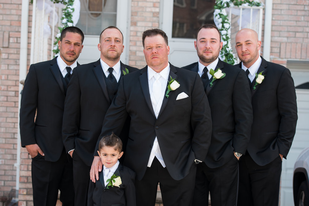 Groom and groomsmen Ike Behar black slim fit tuxedo