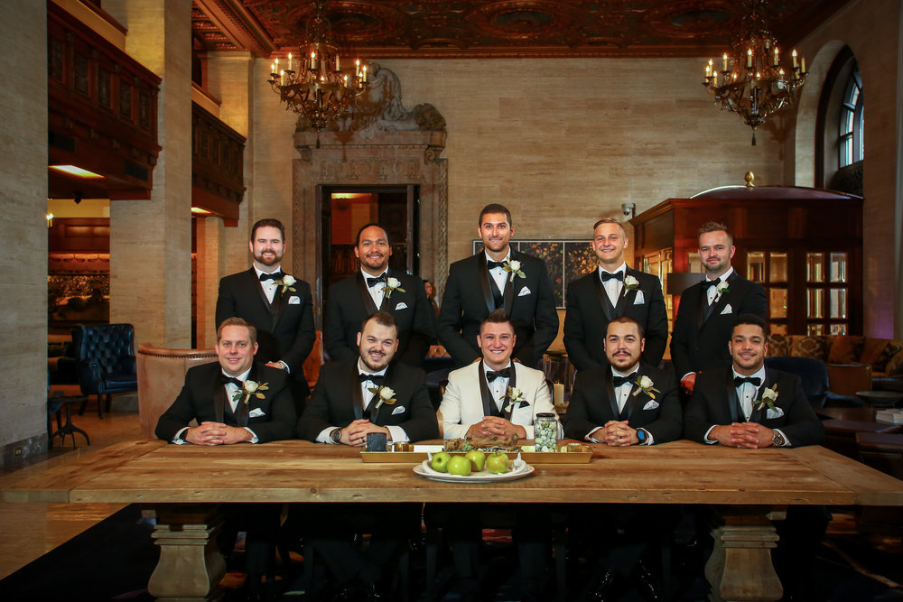 Groom and Groomsmen wearing slim fit tuxedos