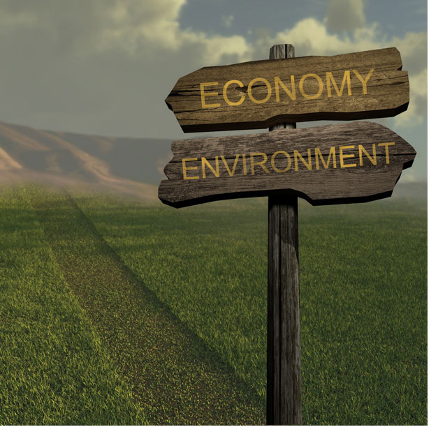 Sign with the Economy pointing one way and the environment pointing the other way.