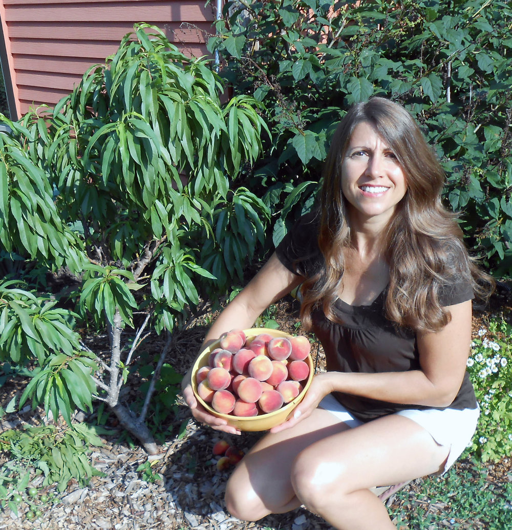 Michelle Hickey grows 43 fruiting shrubs, four hazelnut shrubs, 18 fruit trees, and one almond tree, as well as perennial vegetables.