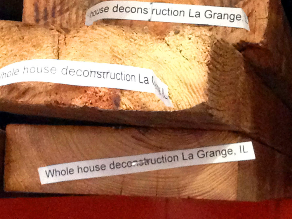 Pieces of wood with labels describing the homes they came from.
