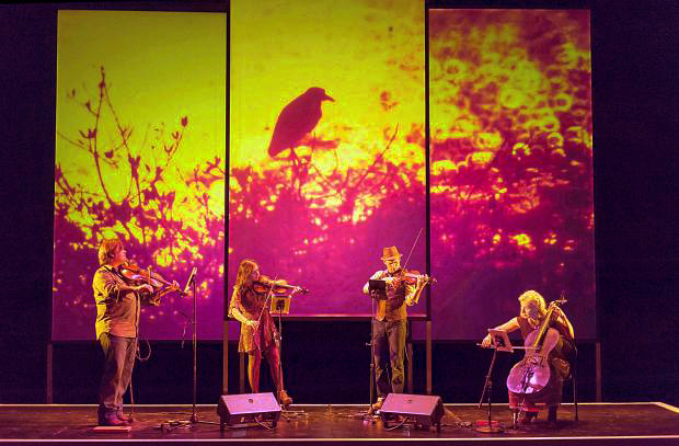 ETHEL, a string quartet with environmental imagery in the background.