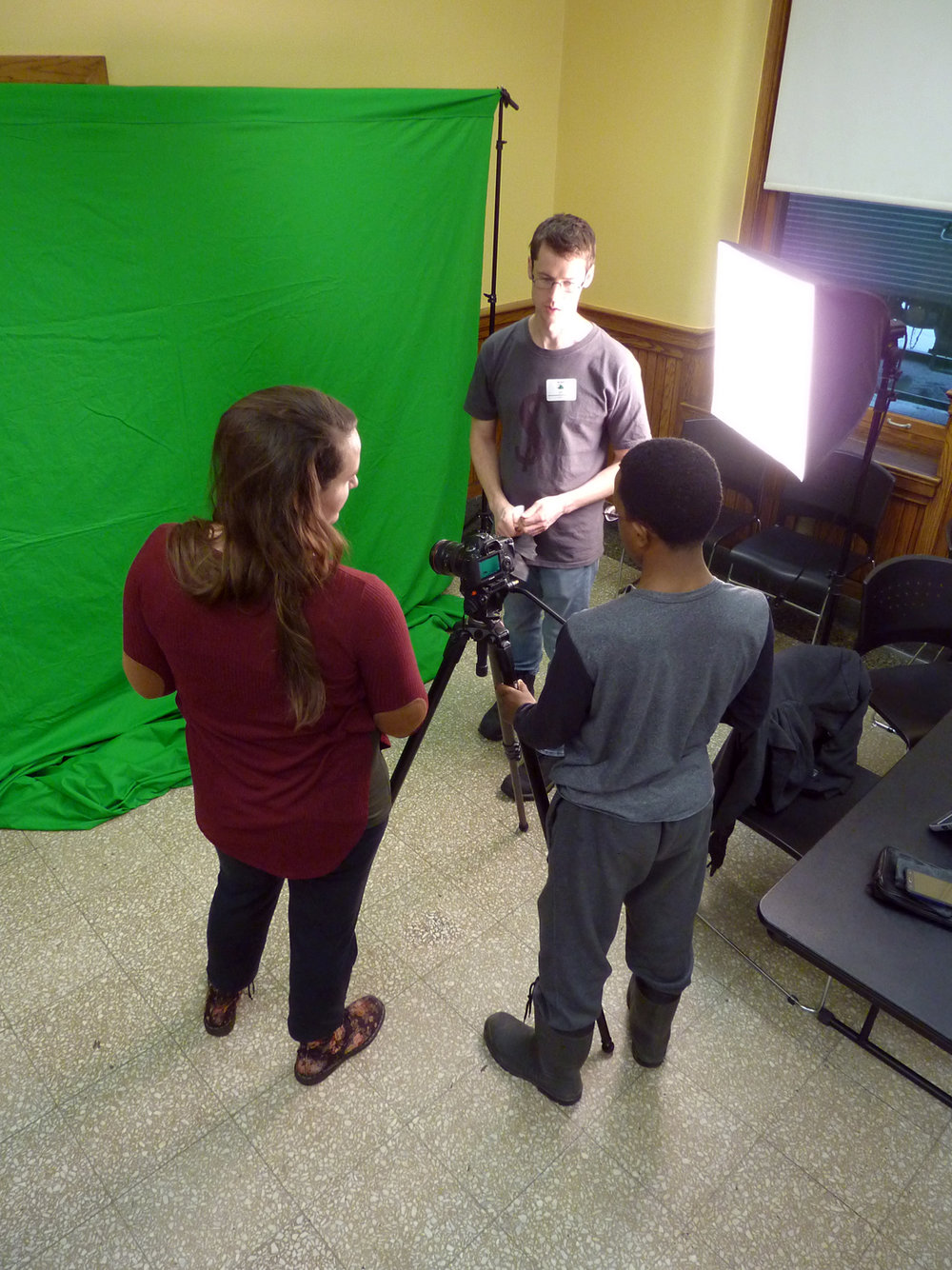 Lauren Travers (left) and Jeff Lassahn (back) showed green screen animation and lighting to students at the Live Action Filmmaking workshops.