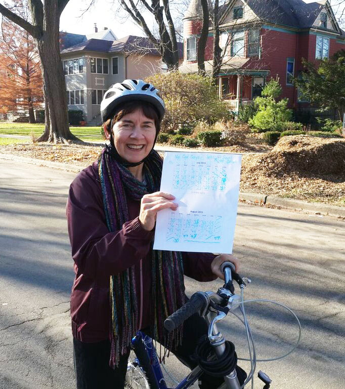 Sally Stovall was inspired to give up driving for 90 days after watching One Earth Film Fest films. She holds the calendar she used for her countdown.