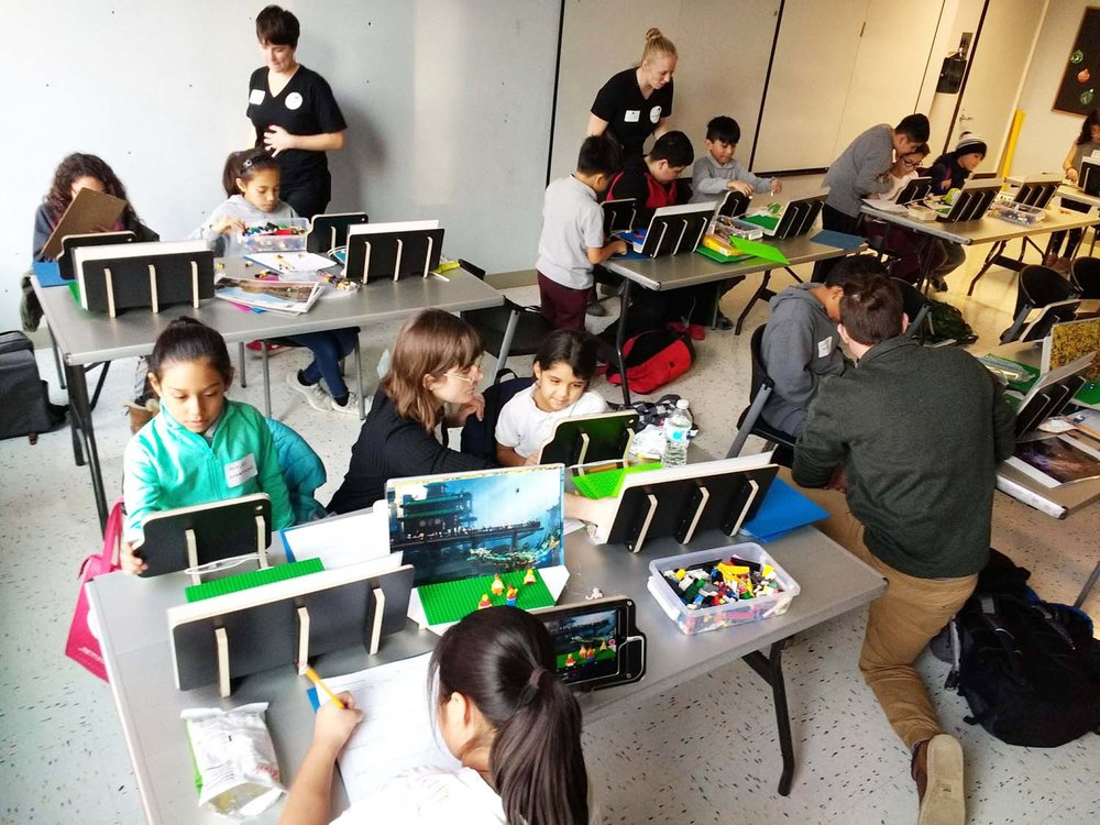 Seventeen students in 3rd through 8th grades, all from Namaste Charter School, learn stop-motion film techniques at Rauner YMCA in Little Village, Chicago.
