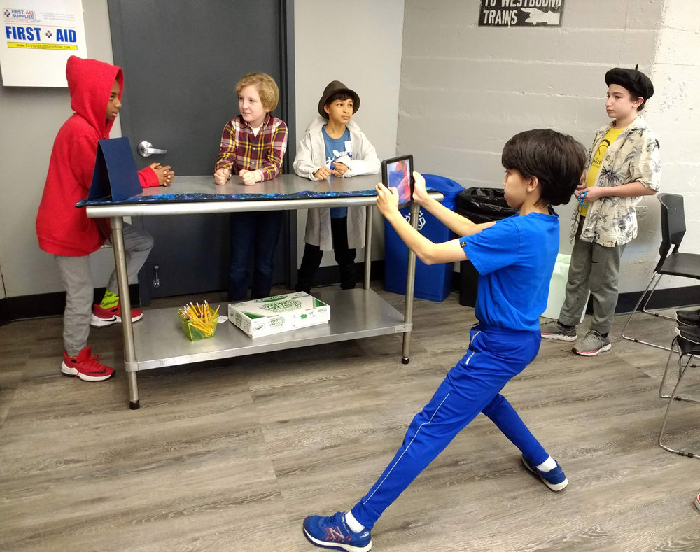 Students in grades 3 through 8 use their iPads and cell phones to shoot footage for narrative films about environmental topics: energy, food, transportation, waste, water, or open space/ecosystems.