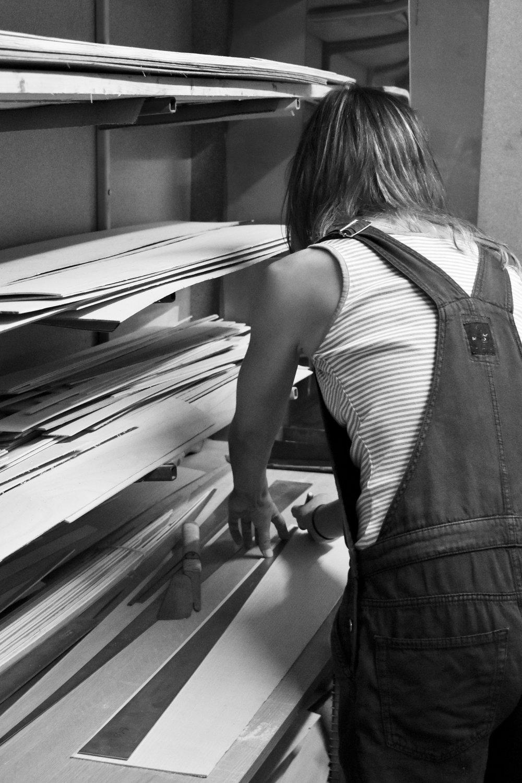 Jane Crisp measuring wood in her studio