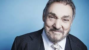 John Rhys-Davies - is a Welsh actor known for his portrayal of Gimli in The Lord of the Rings trilogy and the charismatic excavator Sallah in the Indiana Jones films.
