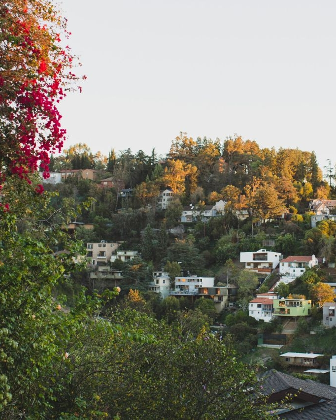 Los Feliz - Los Feliz is a hillside neighborhood in the central region of Los Angeles, abutting Hollywood and encompassing part of the Santa Monica Mountains. Situated on the lower slopes of the fantastic Griffith Park, the Los Feliz neighborhood is a cool trip back in time. Popular with movie stars and entertainment execs since the early 1900s, the area is filled with beautiful art deco, modernist, and mid-century modern homes. Architects like Frank Lloyd Wright and Richard Neutra have left their mark here. The community still draws in celebs, but you'll find creative types, professionals, and families as well.Los Feliz has a small town vibe, with two main streets offering most of the dining and shopping. Excellent restaurants, juice bars, bakeries, bookstores, jewelry, boutiques, vintage clothing stores...it's all packed into the town center.