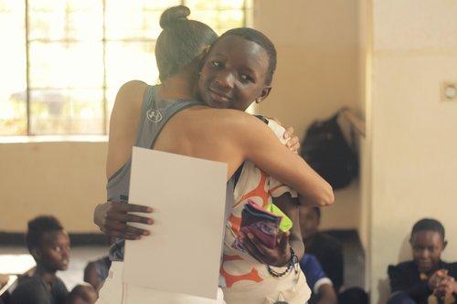 Misty awarding reusable menstrual pads and certificates.