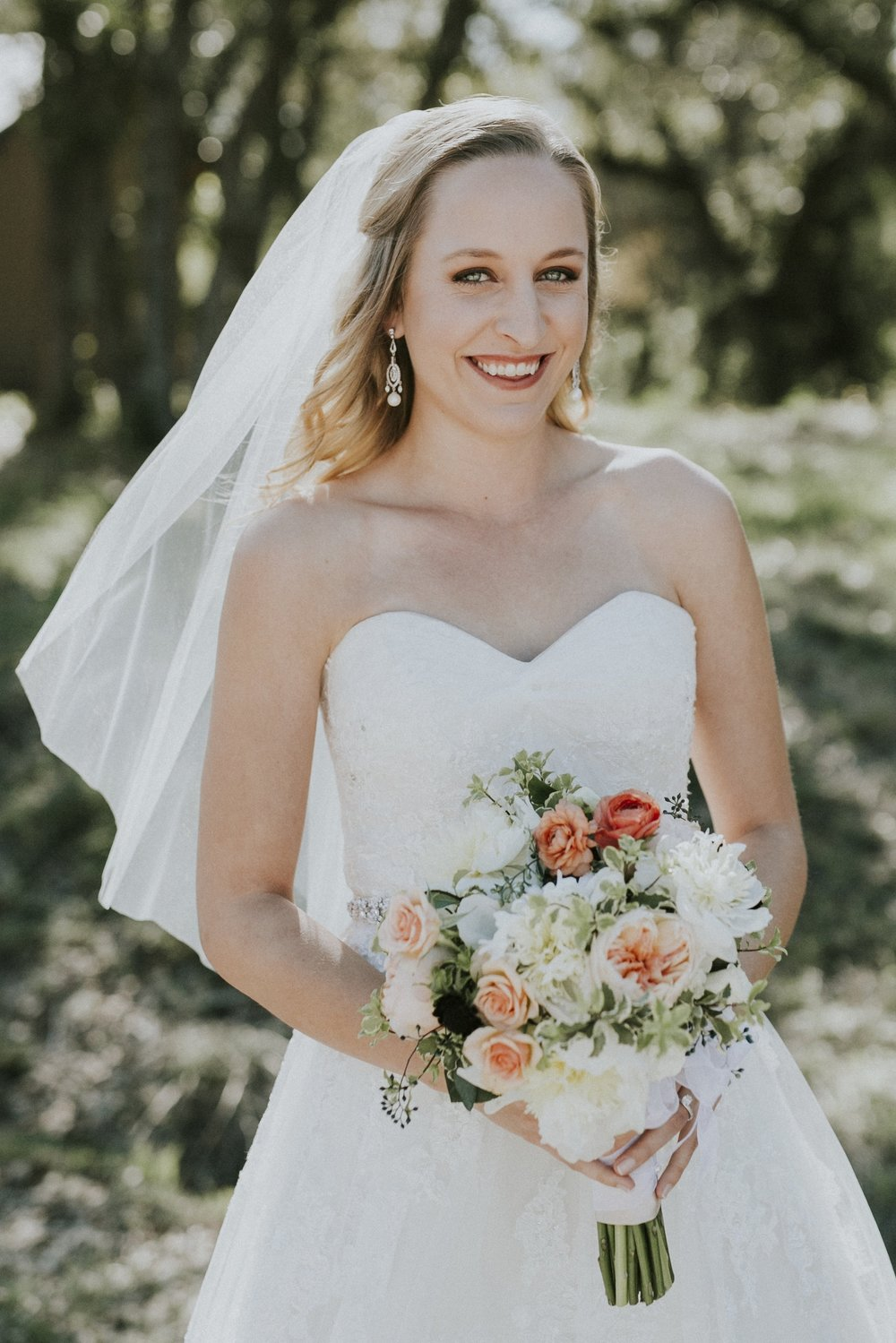 hey there! - I'm Katie Sinclair! I have a passion for painting florals and helping brides-to-be navigate the wedding planning process. I was a bride in 2016 and discovered my love of bouquet painting later that year when I spontaneously decided to paint my own florals (someone has to fill those empty apartment walls, am I right?!).